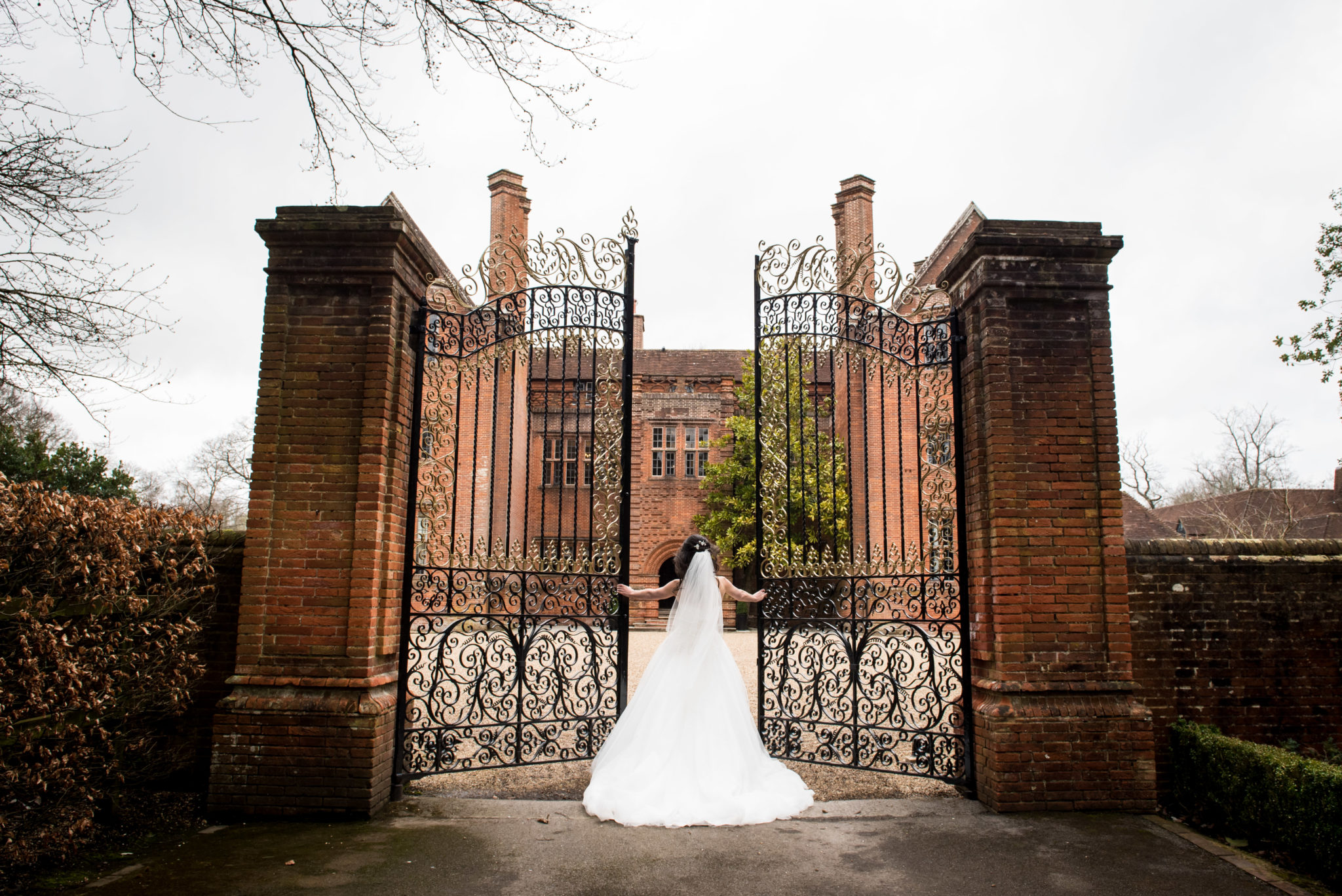 bride at gates of new place hotel in Southampton wedding