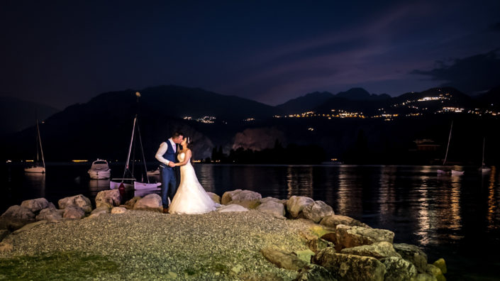married couple kiss in lake garda, italy