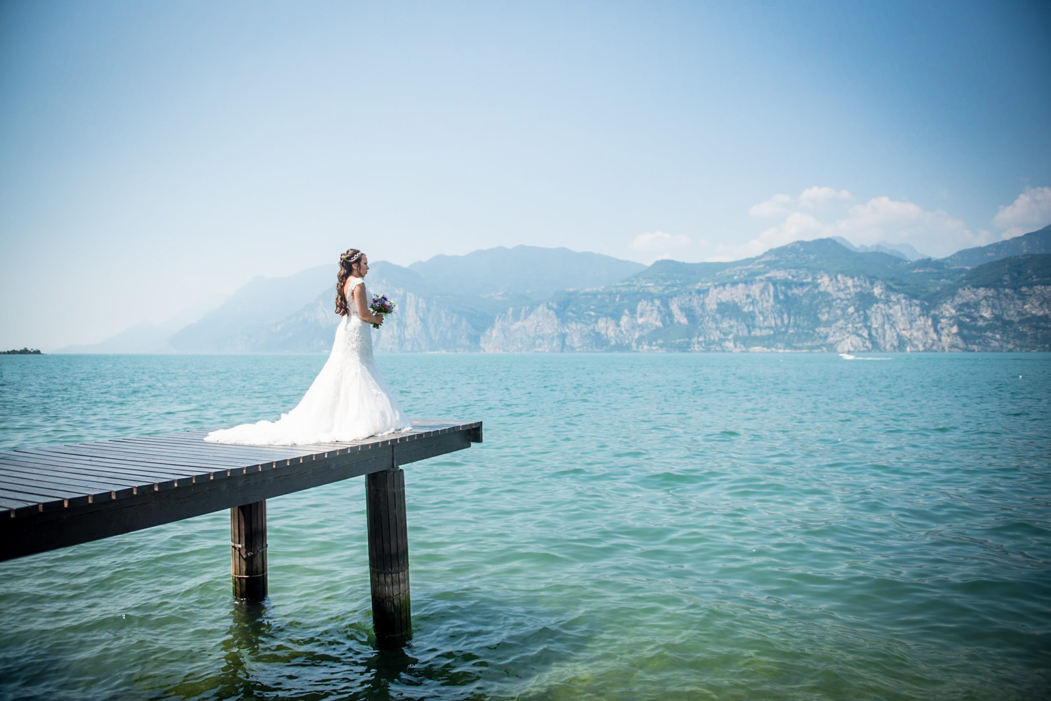 bride overlooking lake Garda on her wedding day